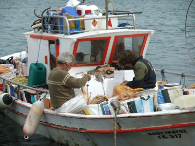 Cypriot fishermen preparing nets